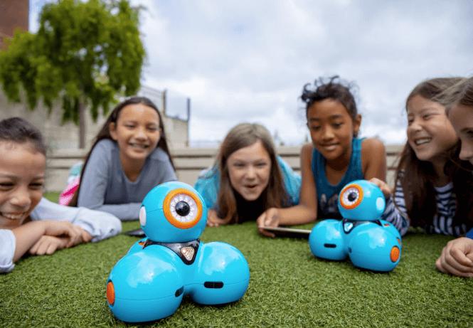 Kids enjoying their wonder workshop dash robots outdoors