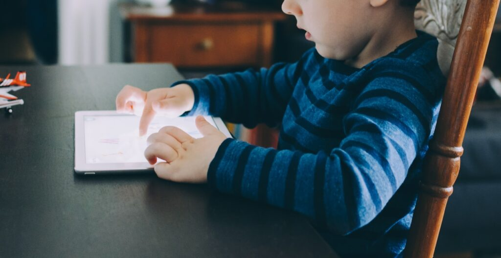 Child using a reading app to learn to read